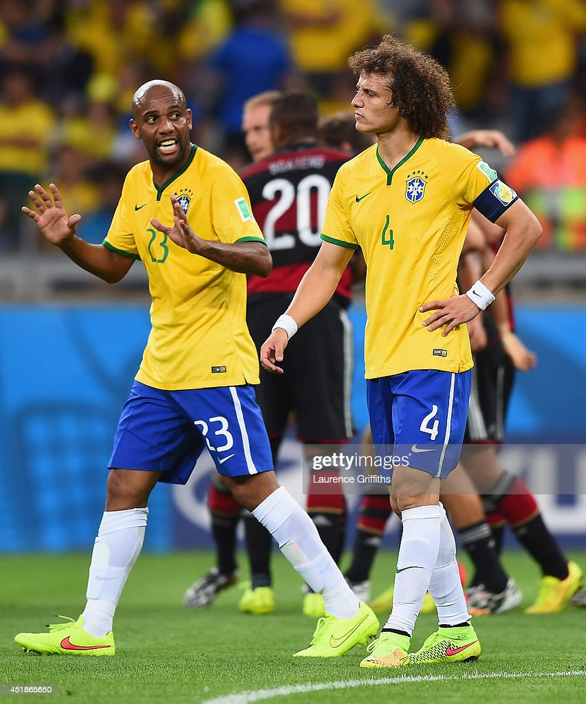 Maicon and David Luiz of Brazil react after allowing a goal during the 2014 FIFA World Cup Brazil Semi Final match between Brazil and Germany at Estadio Mineirao on July 8, 2014 in Belo Horizonte, Brazil.
