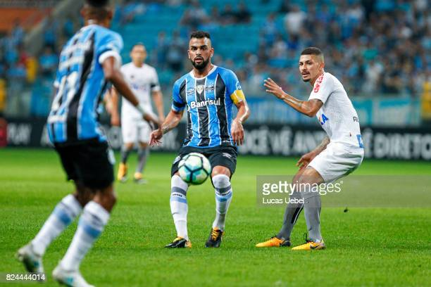 Maicon of Gremio battles for the ball against Alisson of Santos during the match Gremio v Santos as part of Brasileirao Series A 2017 at Arena do...
