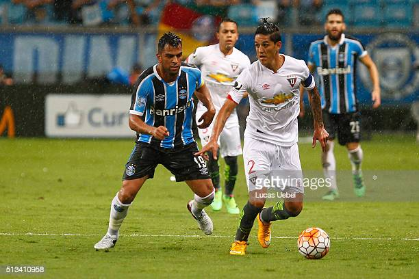 Maicon of Gremio battles for the ball against Norberto Araujo of Liga de Quito during the match Gremio v Liga de Quito as part of Copa Bridgestone...