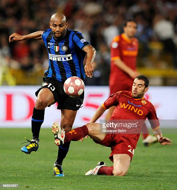 Maicon of Inter challenges Simone Perrotta of Roma during the match the Tim Cup between FC Internazionale Milano and AS Roma at Stadio Olimpico on...