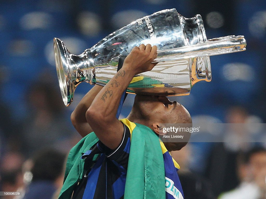 Maicon of Inter Milan celebrates with the UEFA Champions League trophy following his team's victory at the end of the UEFA Champions League Final match between FC Bayern Muenchen and Inter Milan at the Estadio Santiago Bernabeu on May 22, 2010 in Madrid, Spain.