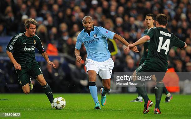 Maicon of Manchester City competes with Fabio Coentrao of Real Madrid during the UEFA Champions League Group D match between Manchester City FC and...