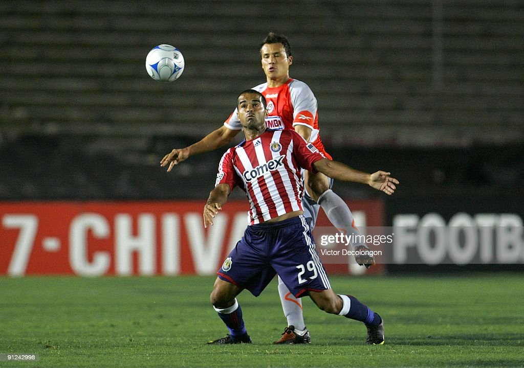 Maicon Santos #29 of Chivas USA plays the ball in front of <a gi-track='captionPersonalityLinkClicked' href=/galleries/search?phrase=Aaron+Galindo&family=editorial&specificpeople=771464 ng-click='$event.stopPropagation()'>Aaron Galindo</a> #3 of Chivas de Guadalajara during the International Club Friendly at the Rose Bowl on September 23, 2009 in Pasadena, California. Chivas de Guadalajara defeated Chivas USA