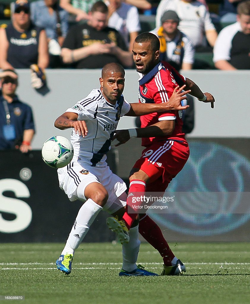 Maicon Santos #29 of the Chicago Fire and Leonardo #22 of the Los Angeles Galaxy vie for the ball during the MLS match at The Home Depot Center on March 3, 2013 in Carson, California. The Galaxy defeated the Fire 4-0.