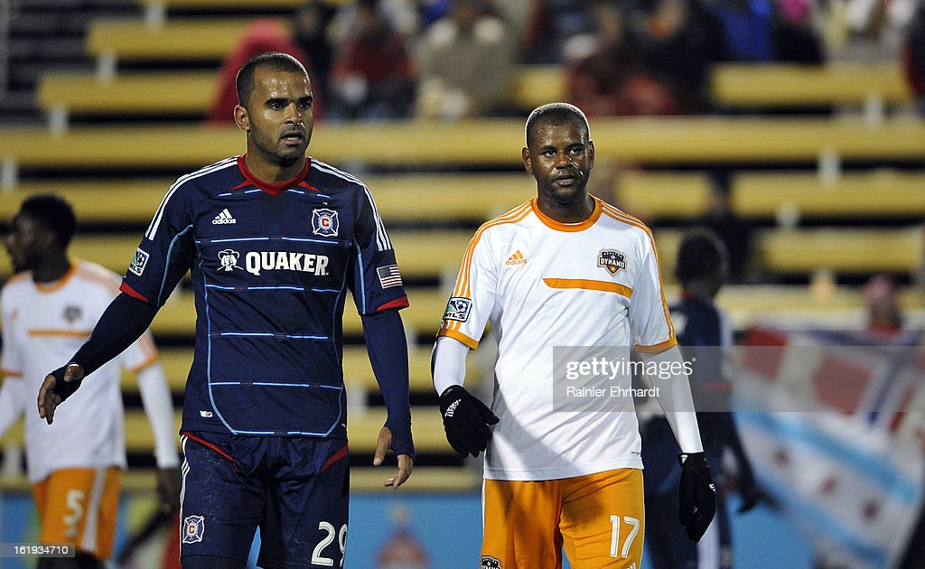 Maicon Santos #29 of the Chicago Fire and Luiz Camargo #17 of the Houston Dynamo walk off the field after their game at Blackbaud Stadium on February 16, 2013 in Charleston, South Carolina.