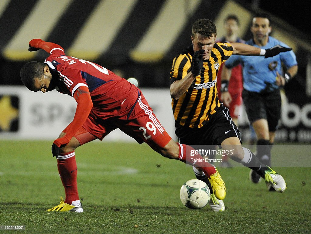 Maicon Santos #29 of the Chicago Fire and Taylor Mueller #4 of the Charleston Battery battle of the ball during the second half of a game at Blackbaud Stadium on February 20, 2013 in Charleston, North Carolina.