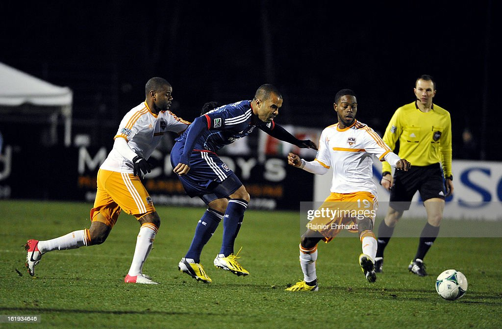 Maicon Santos #29 of the Chicago Fire battles for the ball against Luiz Camargo #17 of the Houston Dynamo and teammate Alex Dixon #19 during the second half of their game at Blackbaud Stadium on February 16, 2013 in Charleston, South Carolina.