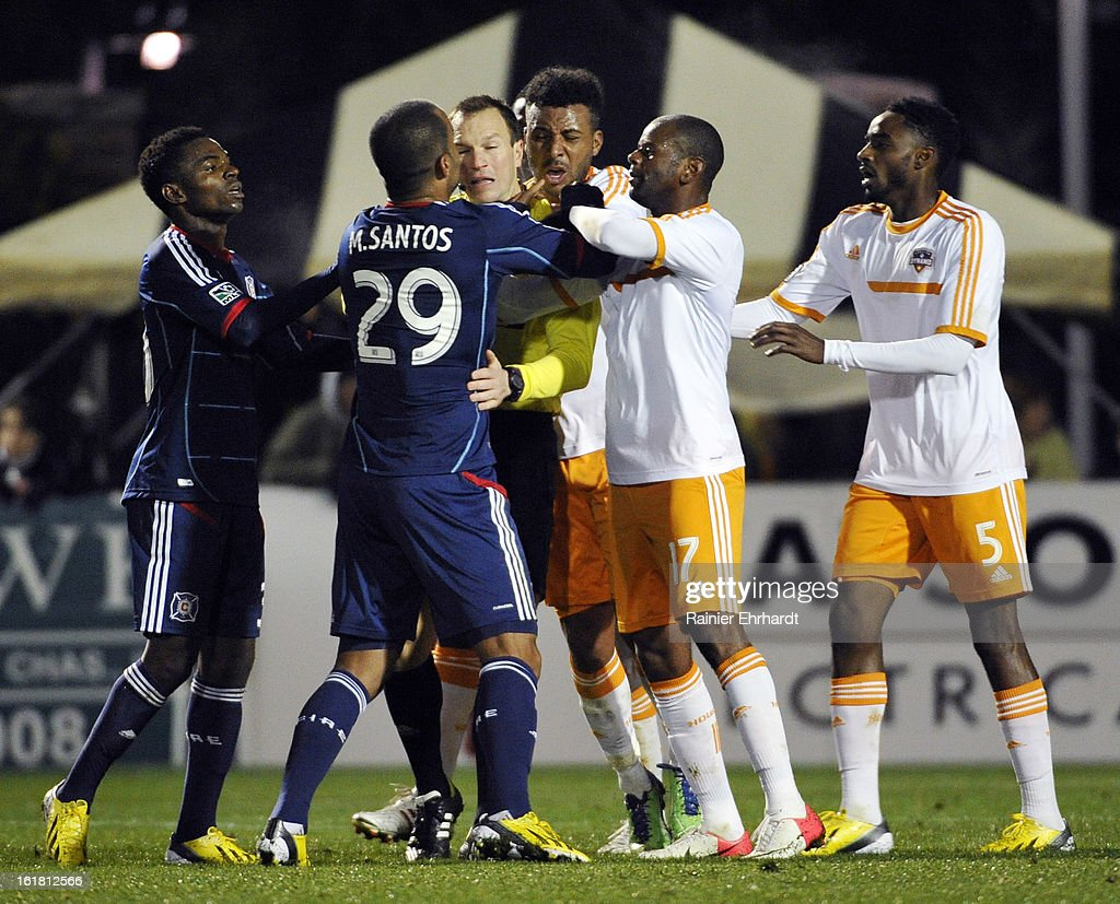 Maicon Santos #29 of the Chicago Fire gets into an altercation with Houston Dynamo players during the second half of their game in the Carolina Challenge Cup at Blackbaud Stadium on February 16, 2013 in Charleston, South Carolina.