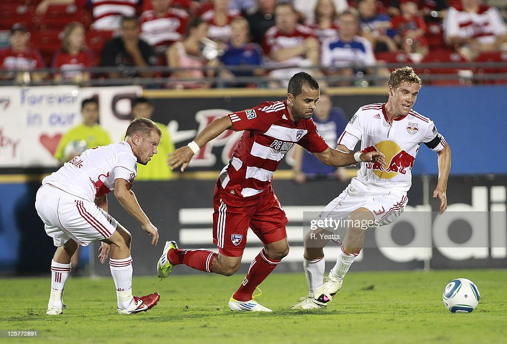 Maicon Santos #9 of the FC Dallas defends the ball from <a gi-track='captionPersonalityLinkClicked' href=/galleries/search?phrase=Chris+Albright&family=editorial&specificpeople=178253 ng-click='$event.stopPropagation()'>Chris Albright</a> #3 of the New York Red Bulls and <a gi-track='captionPersonalityLinkClicked' href=/galleries/search?phrase=Teemu+Tainio&family=editorial&specificpeople=647107 ng-click='$event.stopPropagation()'>Teemu Tainio</a> #2 at Pizza Hut Park on September 17, 2011 in Frisco, Texas. The Red Bulls won 1-0.