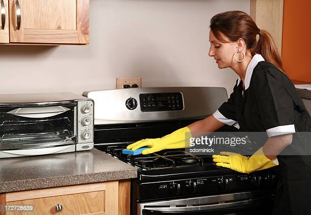 Maid Cleaning A Stove