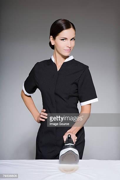 Maid holding an iron