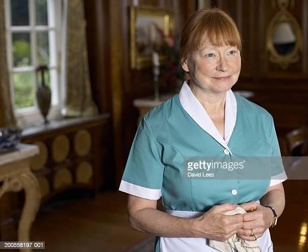 Maid holding napkin, smiling