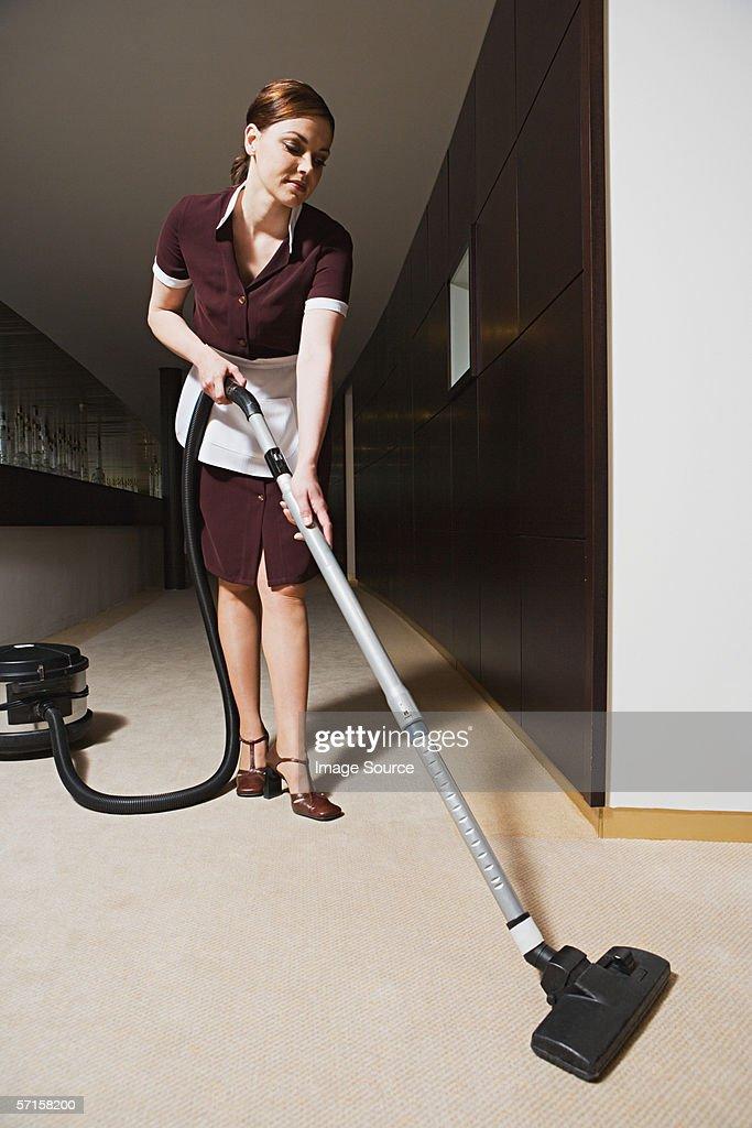 Maid hovering corridor : Stock Photo