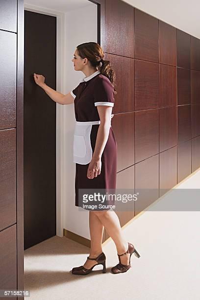 Maid knocking on door