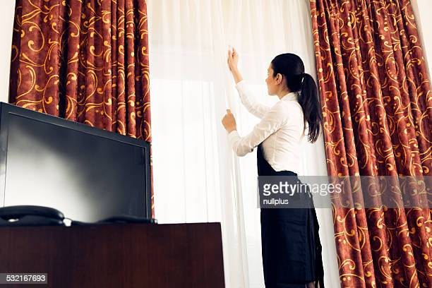 maid making a hotel room