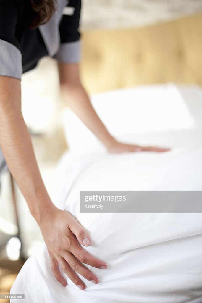Maid making bed : Stock Photo