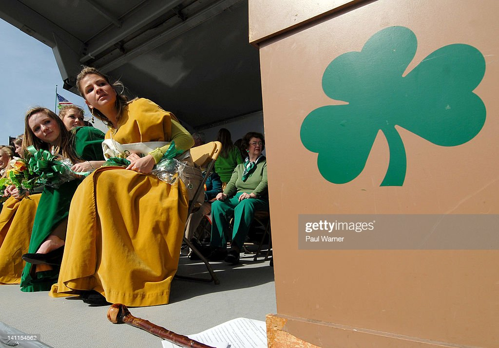 Maid of Erin, Maggie Donnelly (L) and a member of her court, Caitlin Cox, look down the parade route at the St. Patrick's Day Parade on the streets of Detroit on March 11, 2012 in Detroit, Michigan.