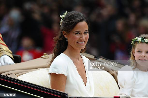 Maid of honour Philippa Middleton and Margarita ArmstrongJones smile as they travel in a SemiState Landau in London after the wedding service for...