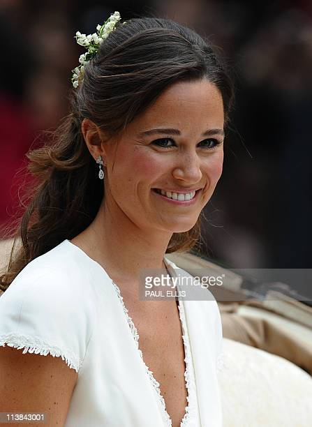 Maid of honour Philippa Middleton smiles as she travels in a SemiState Landau in London after the wedding service for Britain's Prince William and...