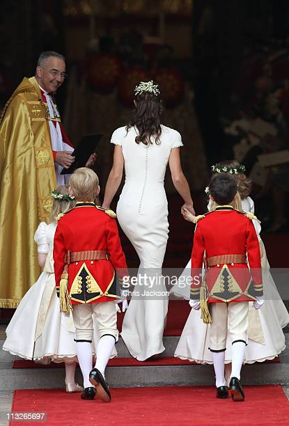 Maid of Honour Pippa Middleton with pageboys and bridemaids is greeted by The Very Reverend Dr John Hall Dean of Westminster as they arrive to attend...