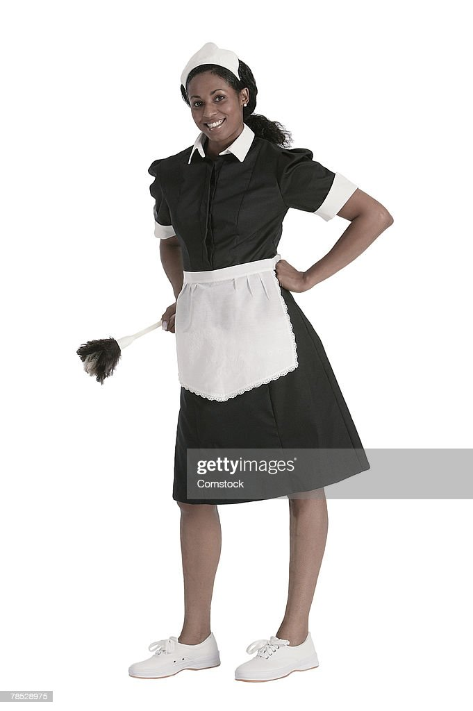 Maid posing with hands on hips