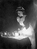 A maid prepares to serve breakfast