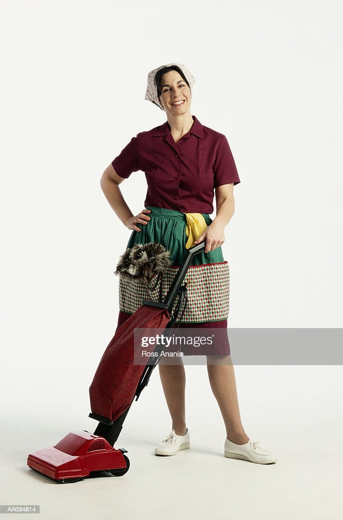 Maid with a Vacuum : Stock Photo