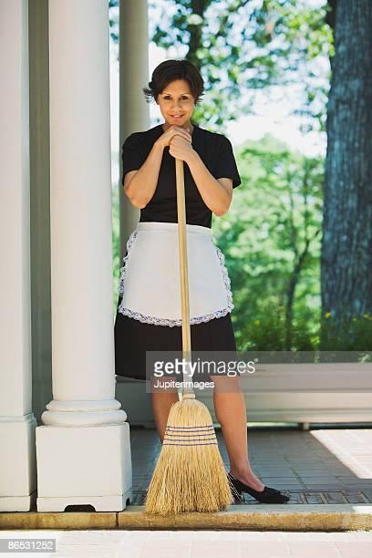 Maid with broom
