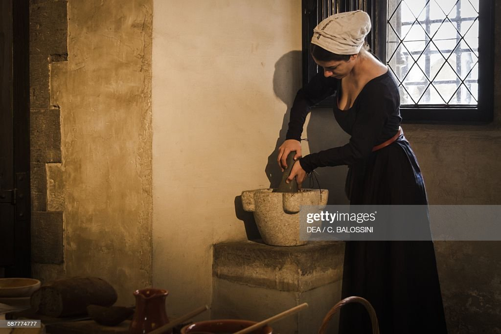A Maid Working At The Stone Mortar In The Kitchen Of A Castle, 15th Century