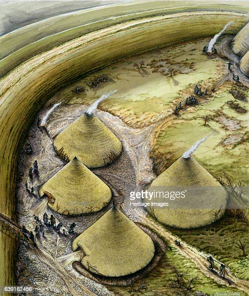 Maiden Castle c5th century BC Reconstruction drawing of a cluster of iron age thatched houses Iron Age hill fort in the English county of Dorset...