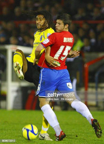 Maidenhead United's Ashan Holgate in action against Aldershot Town's Aaron Morris during FA Cup First Round Replay at the EBB Stadium Aldershot