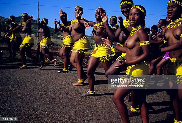 Maidens in traditional clothing dance outside the Royal Palace during the annual Reed Dance on September 11 2004 in Nongoma in rural Natal South...