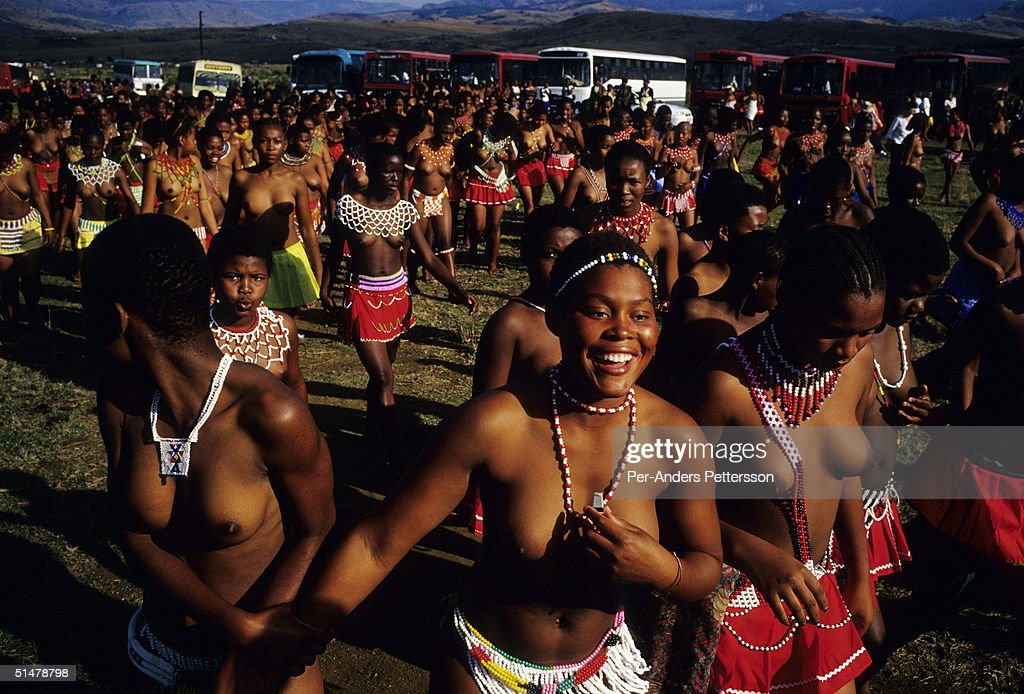 Maidens in traditional clothing line up to dance at the annual Reed Dance on September 11, 2004 in Nongoma in rural Natal, South Africa. About 20,000 maidens from all over South Africa arrived to dance for Zulu King Goodwill Zwelethini at the Enyokeni Royal Palace in Kwa-Nongoma about 350 kilometers from Durban. The girls come to the kingdom to declare their virginity and the ceremony encourages girls and young women to abstain from sexual activity to curb the spread of HIV/AIDS.