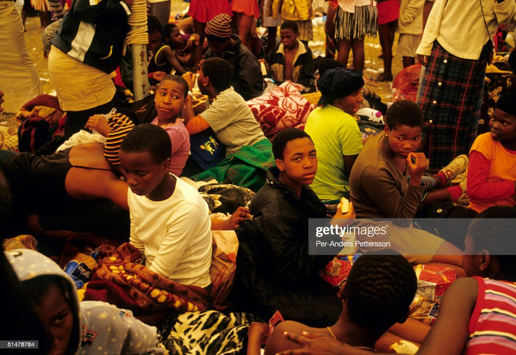 Maidens relax in a big tent after dancing at the annual Reed Dance on September 11, 2004 in Nongoma in rural Natal, South Africa. About 20,000 fellow maidens from all over South Africa arrived to dance for Zulu King Goodwill Zwelethini at the Enyokeni Royal Palace in Kwa-Nongoma about 350 kilometers from Durban. The girls come to the kingdom to declare their virginity and the ceremony encourages girls and young women to abstain from sexual activity to curb the spread of HIVAIDS.
