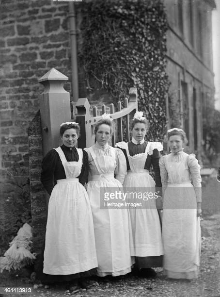 Maids at Church House Charwelton Northamptonshire 1903 A group of four female servants stand by the gate of Church House