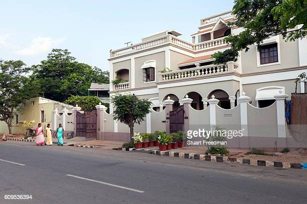Maids walk to work past a period house Pondicherry India Pondicherry is a Union Territory of India and was a French territory until 1954 The French...