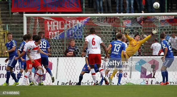 Maik Baumgarten of Erfurt scores the opening goal Goalkeeper Yannik Oettl of Unterhaching without a chance during the Third League match between FC...