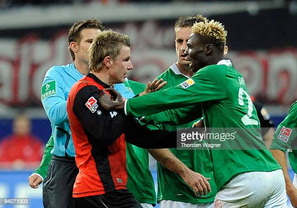 Maik Franz of Frankfurt argues with Aristide Bance of Mainz during the Bundesliga match between Eintracht Frankfurt and FSV Mainz 05 at Commerzbank...