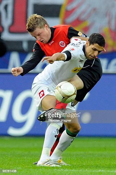 Maik Franz of Frankfurt battles for the ball with Karim Matmour of Moenchengladbach during the Bundesliga match between Eintracht Frankfurt and...