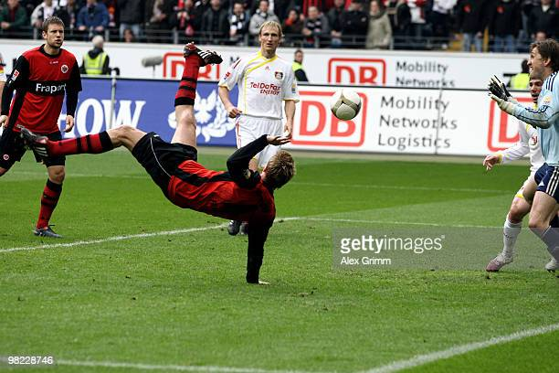 Maik Franz of Frankfurt scores his team's third goal against goalkeeper Rene Adler of Leverkusen during the Bundesliga match between Eintracht...