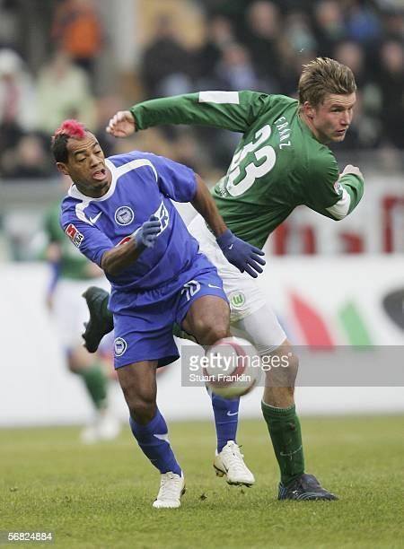 Maik Franz of Wolfsburg challenges Marcelinho of Berlin during the Bundesliga match between VFL Wolfsburg and Hertha BSC Berlin at the Volkswagen...