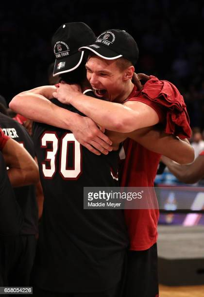 Maik Kotsar and Chris Silva of the South Carolina Gamecocks celebrate after defeating the Florida Gators with a score of 77 to 70 to win the 2017...