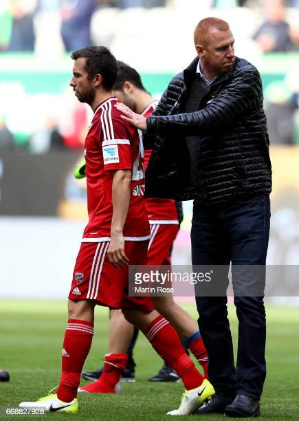 Maik Walpurgis head coach of Ingolstadt comforts Markus Suttner after the Bundesliga match between VfL Wolfsburg and FC Ingolstadt 04 at Volkswagen...