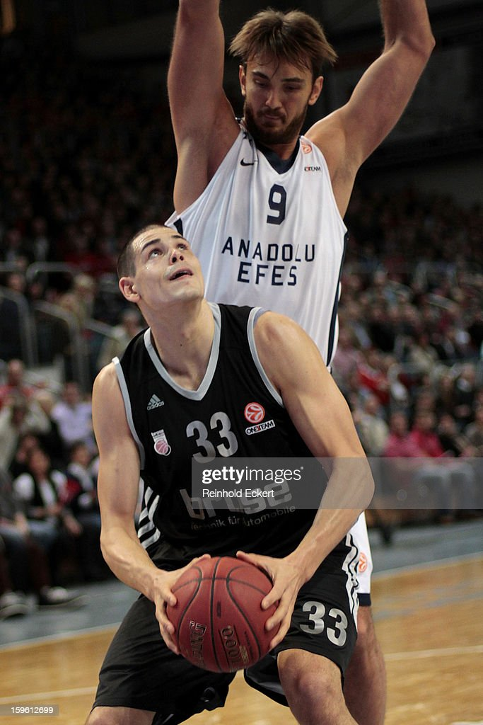 Maik Zirbes, #33 of Brose Baskets Bamberg competes with <a gi-track='captionPersonalityLinkClicked' href=/galleries/search?phrase=Semih+Erden&family=editorial&specificpeople=2550292 ng-click='$event.stopPropagation()'>Semih Erden</a>, #9 of Anadolu Efes Istanbul during the 2012-2013 Turkish Airlines Euroleague Top 16 Date 4 between Brose Baskets Bamberg v Anadolu EFES Istanbul at Stechert Arena on January 17, 2013 in Bamberg, Germany.