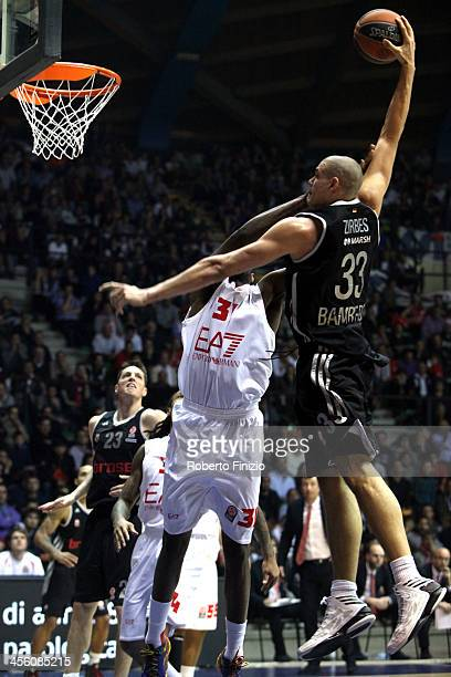 Maik Zirbes #33 of Brose Baskets Bamberg shoots for the basket during the 20132014 Turkish Airlines Euroleague Regular Season Date 9 game between EA7...