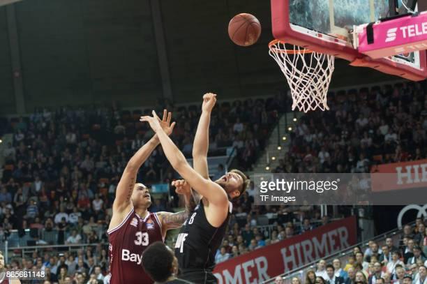 Maik Zirbes of Bayern Muenchen and Leon Kratzer of Wuerzburg battle for the ball during the easyCredit BBL Basketball Bundesliga match between FC...