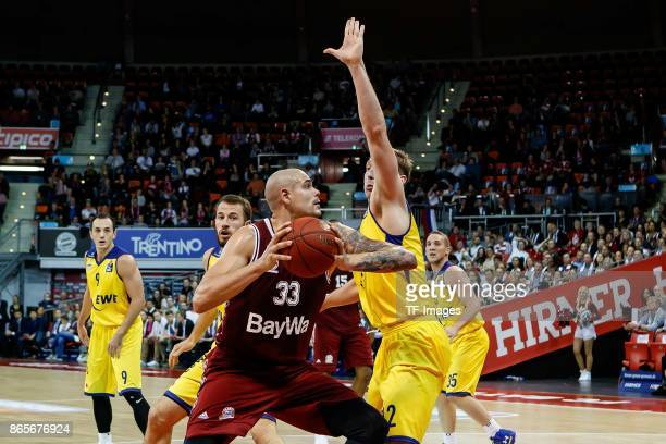 Maik Zirbes of Bayern Muenchen and Maxime de Zeeuw of Oldenburg battle for the ball during the easyCredit BBL Basketball Bundesliga match between FC...