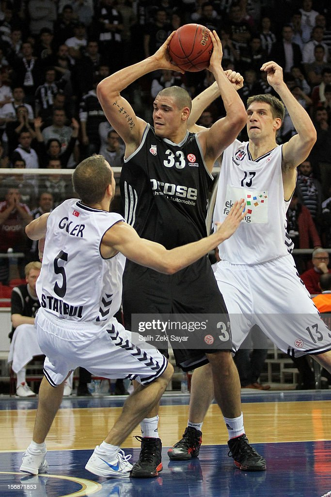 Maik Zirbes of Brose Baskets Bamberg competes with #5 Muratcan Guler and #13 Gasper Vidmar of Besiktas JK Istanbul during the 2012-2013 Turkish Airlines Euroleague Regular Season Game Day 7 between Besiktas JK Istanbul v Brose Baskets Bamberg at Abdi Ipekci Arena on November 23, 2012 in Istanbul, Turkey.