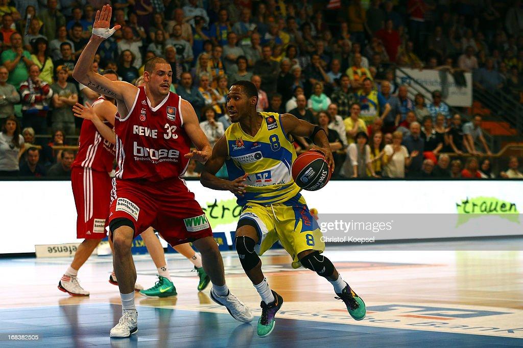 Maik Zirbes of Brose Baskets Bamberg defends against Mark Dorris of Phoenix Hagen during the second Beko BBL Bundesliga Playoff match between Phoenix...