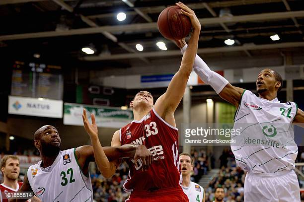 Maik Zirbes of Brose Baskets is challenged by Jermaine Bucknor and Barry Stewart of Trier during the Beko BBL Basketball Bundesliga match between TBB...
